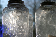Bee hive glass jars. Close up of bee hive jars in a country general store in Cape Cod royalty free stock photo
