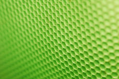 Bee hive in green. Marco shot of a bee hive shaped background in green stock images