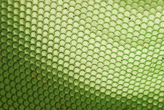Bee hive in green. Marco shot of a bee hive shaped background in green royalty free stock photo