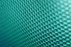 Bee hive in green. Marco shot of a bee hive shaped background in green royalty free stock photos