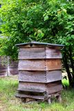 Bee hive. A wooden slatted bee hive, in a rural setting royalty free stock images