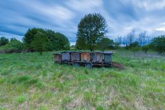 Bee hives on trail in rural landscape Royalty Free Stock Images