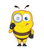 Bee holding a magnifying glass. Clipart picture of a bee cartoon character holding a magnifying glass Royalty Free Stock Photo