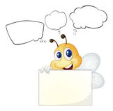 A bee holding a white board Royalty Free Stock Image