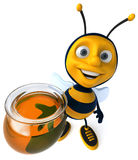 Bee and honey Stock Images