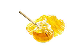 Bee honey and honeycomb. Pot of honey with stick and bee honeycomb isolated on white background. Honey spoon in glass jar and honeycombs wax Royalty Free Stock Photo