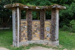 Bee house. Bee or insect house in a park stock photo