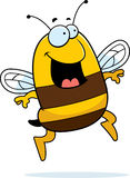 Bee Jumping. A cartoon bee jumping and smiling Stock Photos