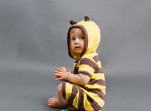 Bee kid. Kid wearing a bumble bee costume Stock Photo