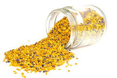 Bee Pollen. Jar bee pollen on a white background royalty free stock images