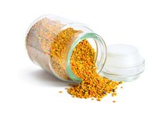 Bee pollen baskets in the glass jar. isolated on white background.  stock images