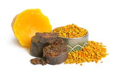 Bee pollen baskets with Propolis or bee glue and with Beeswax. Isolated on white background.  stock photos