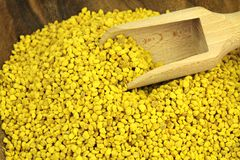 Bee pollen. Bee pollen in a wood plate and scoop Royalty Free Stock Images