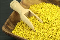 Bee pollen. Bee pollen in a wood plate and scoop Stock Images