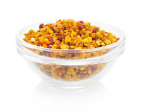 Bee pollen in the bowl on white background Stock Photos