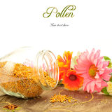 Bee Pollen with copy space for text. Bee pollen in glass jar and flowers with copy space for text royalty free stock image