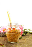 Bee pollen in glass jar and spoon Royalty Free Stock Photo