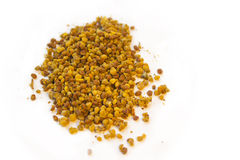 Bee pollen. Isolated on white background royalty free stock image