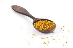 Bee pollen n wooden spoon Royalty Free Stock Image