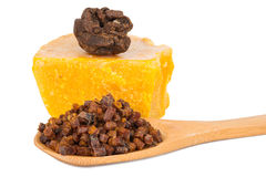 Bee pollen and propolis wax. On white background Stock Photos