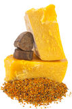 Bee pollen and propolis wax. On white background Stock Photo