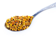Bee pollen and spoon Stock Images