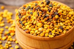 Bee pollen in wooden bowl royalty free stock photography