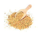 Bee pollen in wooden scoop Stock Photos