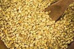 Bee pollen in wooden scoop. Nutritional supplement royalty free stock photos