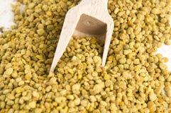 Bee pollen in wooden scoop. Nutritional supplement royalty free stock image