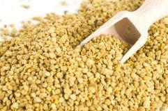 Bee pollen in wooden scoop. Nutritional supplement royalty free stock photo