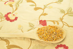 Bee pollen in wooden spoon Royalty Free Stock Photography