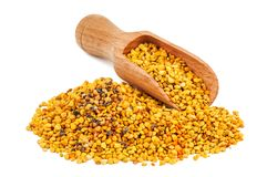 Bee pollen and wooden spoon royalty free stock image