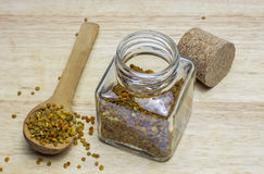 Bee pollen granules in wooden spoon Royalty Free Stock Photos