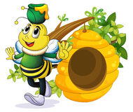 A bee with a pot above its head near the beehive Royalty Free Stock Photo