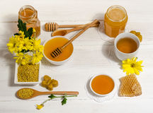 Bee products on wooden table Royalty Free Stock Photos