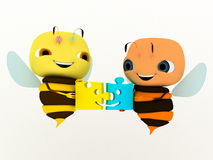 Bee puzzle. Two bees put a puzzle Royalty Free Stock Photo