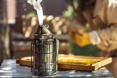 Bee Smoker. Beekeeping,Wooden beehive and bees, Bee smoke sprayer stock images