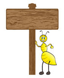 Bee with wooden banner Royalty Free Stock Photography