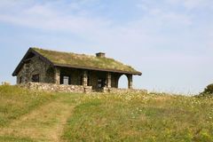 Beech Hill Preserve, Rockport, Maine. Beautifully restored stone house with sod roof Royalty Free Stock Photos