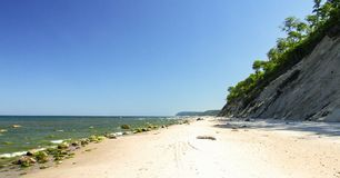 Beach in Wolin National Park in Western Poland. High and steep cliff. Stones and rocks on beach. Photo in 16:9 format Stock Photography