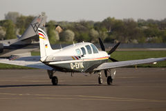 Beechcraft A36 Bonanza business aircraft running on the runway Stock Photography