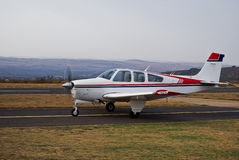 Beechcraft Bonanza takeoff Royalty Free Stock Image