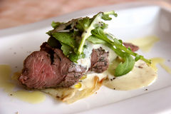 Beef. Mediterranean cuisine medium-well beef in a light cream sauce close-up royalty free stock image