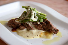 Beef. Mediterranean cuisine medium-well beef in a light cream sauce close-up royalty free stock photography