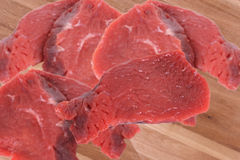 Beef. Picture filled with beef on a wooden background Royalty Free Stock Image