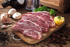 Beef. Several beef patty on chopping board with ingredients Stock Photography
