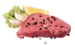 Beef. Steak with vegetables on white background Stock Photos
