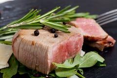 Beef on arugula salad and parmesan Stock Photo