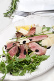 Beef on arugula salad and parmesan Stock Images